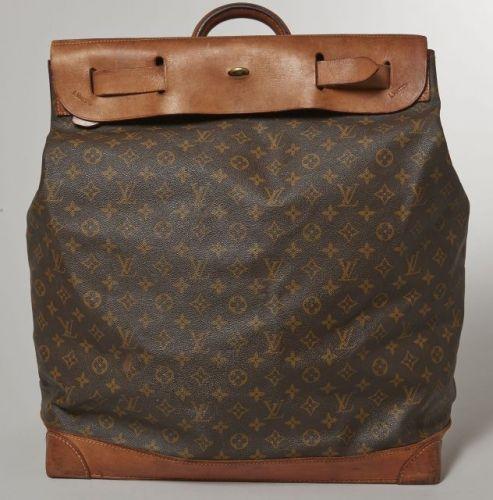 Louis VUITTON, Sac de voyage collection Steamer Bag, en toile Monogram et  cuir naturel, fermeture à rabat à deux sangles. 54 x 44 cm. 8017eba8032