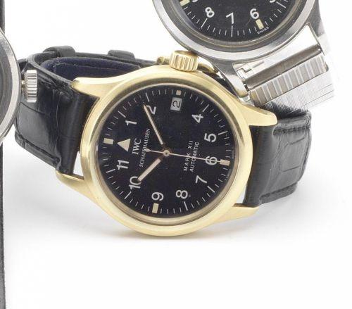 b5080539e685 IWC. A fine 18ct gold centre seconds calendar wristwatch. Description   Mark  XII ...