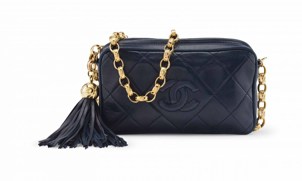 886818d801f9 A NAVY LAMBSKIN LEATHER CAMERA BAG WITH GOLD HARDWARE CHANEL, 1991-1994